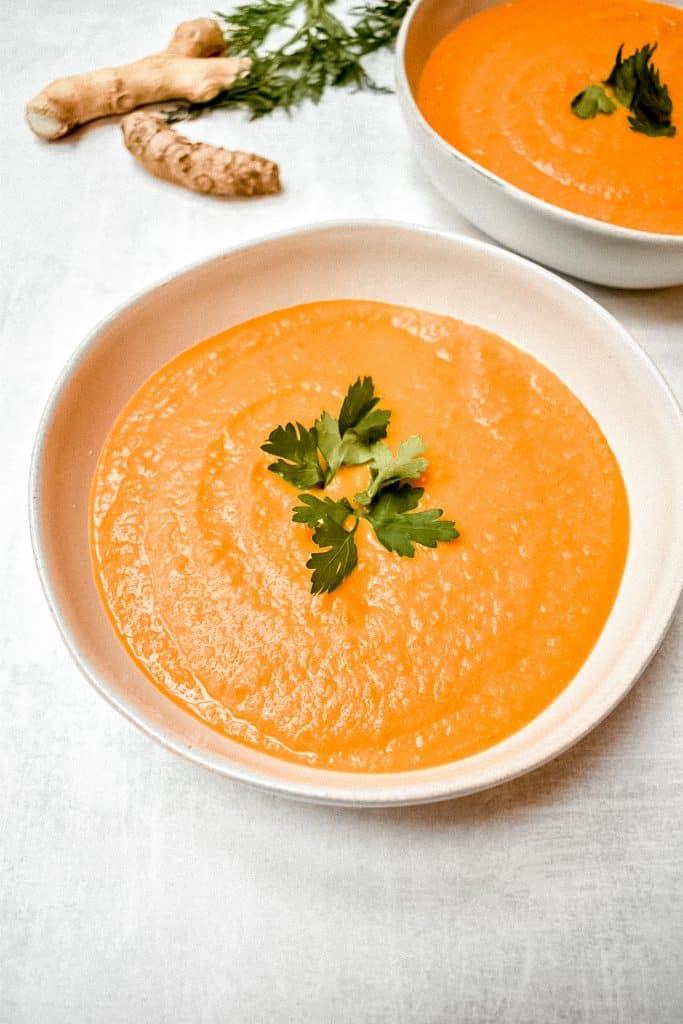carrot ginger soup on orange background