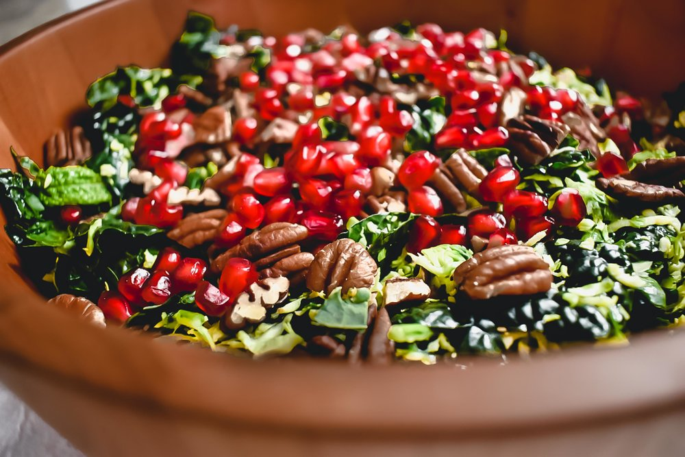 kale and Brussels sprout salad with pomegranates and pecans
