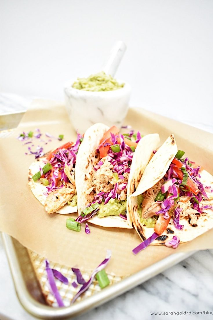 Smoky and slightly spicy chicken paired with creamy guacamole and a crunchy citrus slaw all nestled in a charred tortilla make these tacos a must for your weeknight dinner rotation or Cinco de Mayo celebrations.