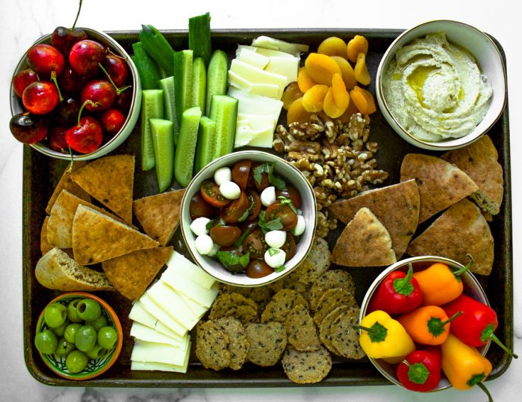 overhead shot of mediterranean mezze platter on sheetpan