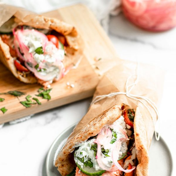 Greek Style Salmon Gyros with Tzatziki and Quick Pickled Onions